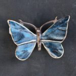 Bronzeornament bunter Schmetterling